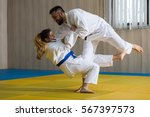 young woman and man judo...   Shutterstock . vector #567397573