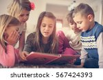 girl reads a story to her... | Shutterstock . vector #567424393