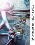 Small photo of Vintage skeleton doll Rastaman cycling