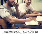 Men Play Guitar Write Song...