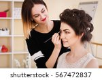 make up artist doing make up... | Shutterstock . vector #567472837