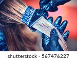 professional hairdresser dyeing ... | Shutterstock . vector #567476227