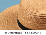 Small photo of Straw Hat with plain design, wide brim, and a simple black band, worn by Amish farmers.