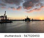 sunrise in the harbour of las... | Shutterstock . vector #567520453