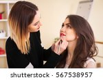 make up artist doing make up... | Shutterstock . vector #567538957