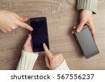 top view of two people's hands...   Shutterstock . vector #567556237