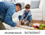 father and son assembling... | Shutterstock . vector #567605647