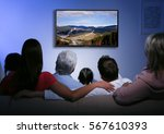 family watching television at... | Shutterstock . vector #567610393