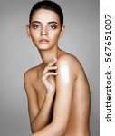 beautiful tanned girl apply the ... | Shutterstock . vector #567651007