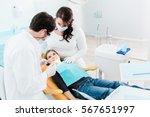 dentist trearing child in his... | Shutterstock . vector #567651997