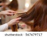 hairdresser combing her long ... | Shutterstock . vector #567679717