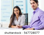 serious businessman with young... | Shutterstock . vector #567728077