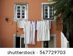 linen hanging on a street in... | Shutterstock . vector #567729703