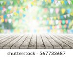 empty wooden table with party... | Shutterstock . vector #567733687
