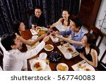 adults at a dinner party ... | Shutterstock . vector #567740083