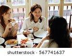 women sitting in cafe  having... | Shutterstock . vector #567741637