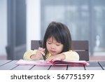 cute little girl doing homework ...   Shutterstock . vector #567751597