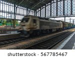 Small photo of A freight train or goods train in motion on a train station. Motion blur