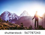 hiker with backpacks reaches... | Shutterstock . vector #567787243