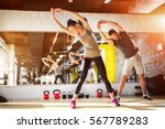 Stock photo young athletes stretching at the gym 567789283