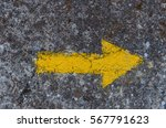 Yellow Arrow Painted In A Wall...