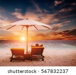 woman on sunbed under umbrella... | Shutterstock . vector #567832237