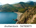 Beach in a bay on Corsica - stock photo