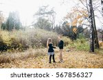 young couple walking in autumn... | Shutterstock . vector #567856327