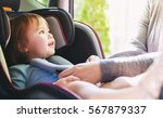 toddler girl buckled into her... | Shutterstock . vector #567879337