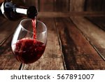 red wine in glass on wooden...