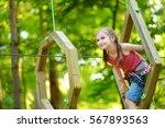 adorable little girl enjoying... | Shutterstock . vector #567893563