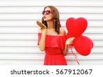 portrait woman in red dress... | Shutterstock . vector #567912067
