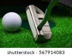 golf ball  with putter near to... | Shutterstock . vector #567914083