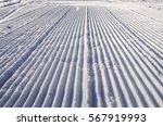 fresh snow groomer tracks on a... | Shutterstock . vector #567919993