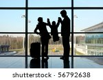 silhouette of parents holding... | Shutterstock . vector #56792638