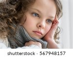 sad little girl sits alone and... | Shutterstock . vector #567948157