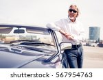 senior man standing next to... | Shutterstock . vector #567954763