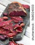 sliced homemade smoked beef.... | Shutterstock . vector #568024033