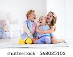 group of three kids playing in... | Shutterstock . vector #568035103