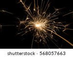 fire sparklers on black... | Shutterstock . vector #568057663