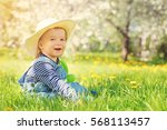 Baby Boy Sitting On The Grass...