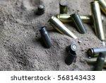 bullet in the sand   Shutterstock . vector #568143433