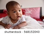 baby boy sitting on the bed... | Shutterstock . vector #568152043
