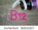 pink pills forming shape to b12 ... | Shutterstock . vector #568161817