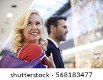 mature couple on shopping tour   | Shutterstock . vector #568183477