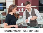 jeweler presenting and talking... | Shutterstock . vector #568184233