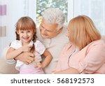grandparents with granddaughter ... | Shutterstock . vector #568192573
