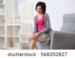 young woman suffering from pain ... | Shutterstock . vector #568202827