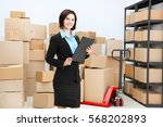 young woman with clipboard in... | Shutterstock . vector #568202893