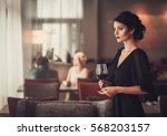 elegant brunette lady in black...   Shutterstock . vector #568203157
